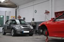 Ferrari F430 and Mini Cooper S in Body Shop