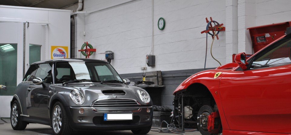 Ferrari F430 and Mini Cooper S in Body Shop